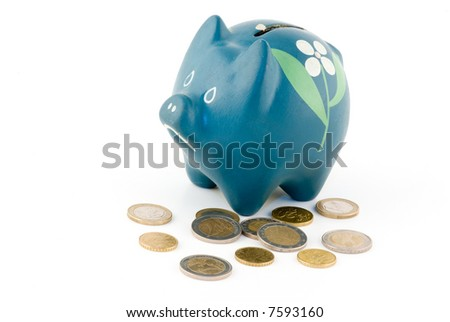 blue piggy bank with coins on white background