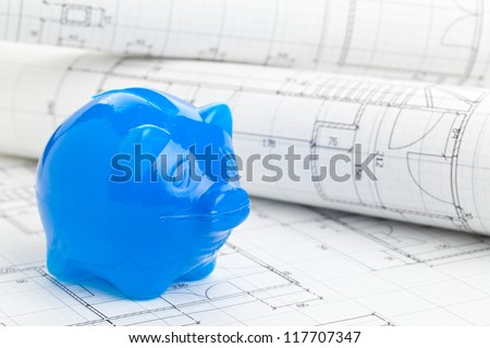 Blue piggybank home construction plans - home building financing concept