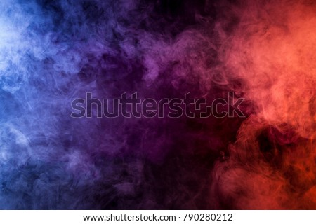 Blue, pink, purple vape smoke on black isolated background