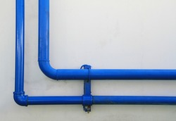Blue pipes on the wall