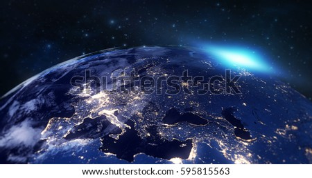 blue planet earth from space showing europe continent at night, globe world with blue glow edge and sun light sunrise on space in a star field background, some elements of this image furnished by NASA #595815563