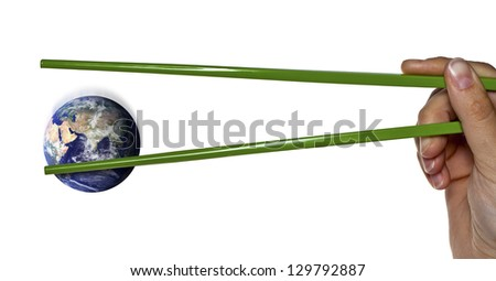 """Blue planet earth seems to be lost between green chopsticks or it is being caught. """"Elements of this image furnished by NASA"""""""