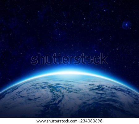 Stock Photo Blue Planet Earth sunrise over cloudy ocean with stars in the sky, An eclipse of the Sun by the world make rising sun in space can use for background - Elements of this image furnished by NASA