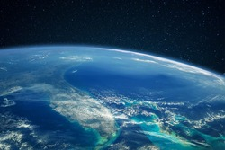 Blue planet earth with ocean and continents in open space on the starry sky
