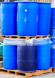 Blue plastic barrels on paletts in a chemical plant
