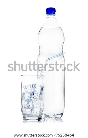 Blue plastic bottle of mineral water and glass with ice cubes and straw on white background