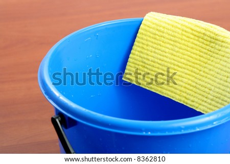 Blue plastic bucket and napkin