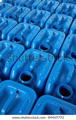 Blue plastic canister in rows