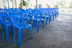 blue plastic chairs in line.