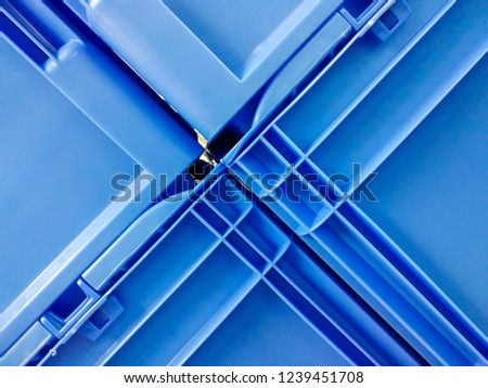 Blue plastic container boxes on top of each other #1239451708