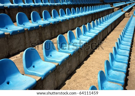 blue plastic empty seats on football stadium