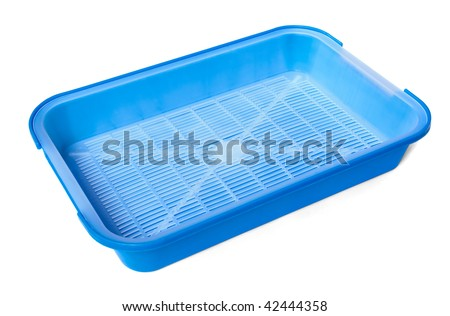 Blue plastic litter box isolated on white - stock photo
