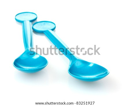 blue plastic spoons isolated on white
