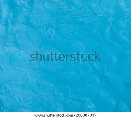 Blue Plasticine finger textured background.