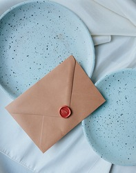 Blue plates with a coffee cup and envelop for a mock up or lifestyle picture instagram, pinterest design elements for Easter such as  eggs, pampas grass, envelop