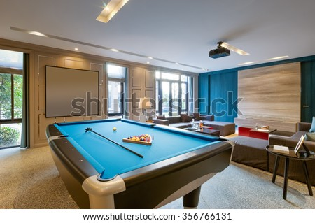 blue pool in luxury recreation room