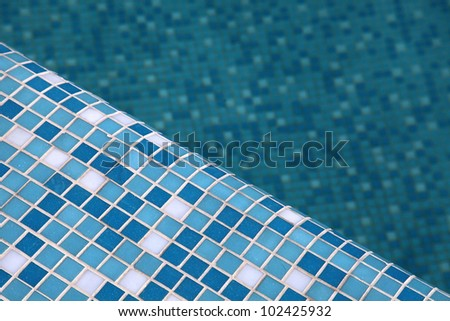 Blue pool tile background. Selective focus