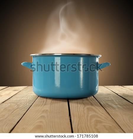 blue pot of hot food  - stock photo