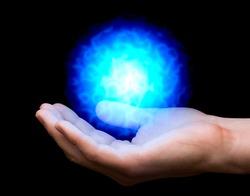 blue power fireball on man's hand