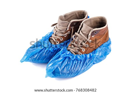 blue protective shoe covers on men's shoes isolated on white background #768308482