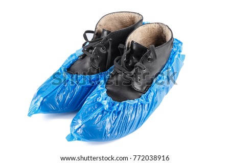 blue protective shoe covers on men's shoes isolated on white background #772038916