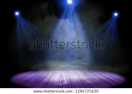 Blue purple lighting and smoke on stage with floor wood #1286725630