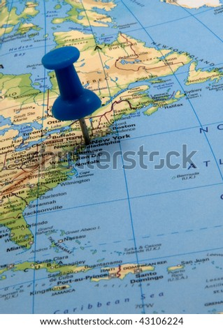 Blue push pin in a map, indicating the position of New York, USA - stock photo