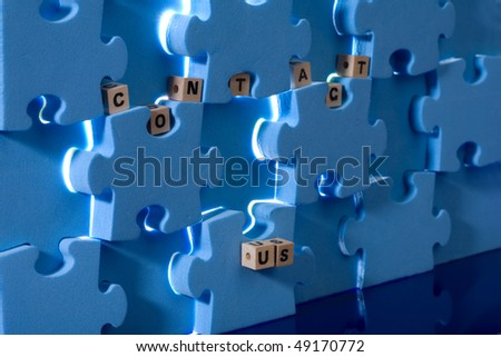 Blue puzzle with wood letter