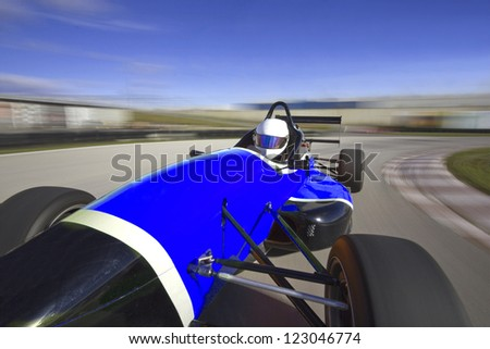 blue racing car driving at high speed in circuit.Camera on board