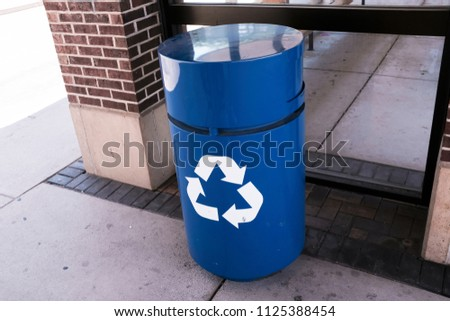 Blue Recycle Bin On The Street