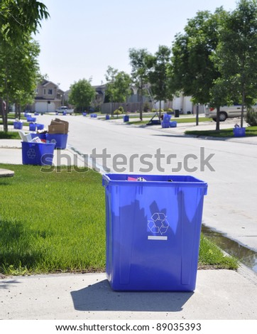 Blue recycling box outside the sidewalk on garbage day
