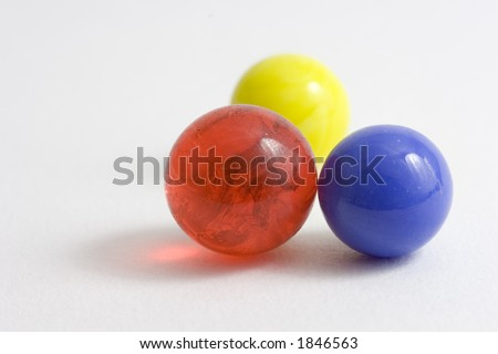Blue, red and yellow marble with shallow depth of field - stock photo
