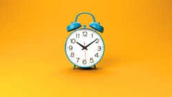 blue retro alarm clock on orange background