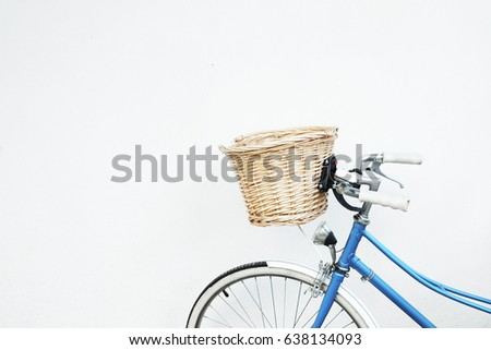 blue retro bicycle with basket...