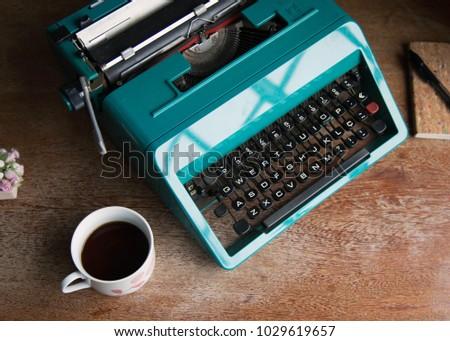 blue retro typewriter sitting...