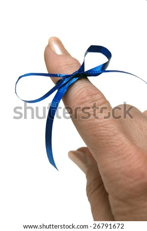 Blue ribbon tied around finger as a reminder on white background