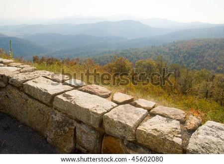 blue ridge mountains and stone fence - stock photo