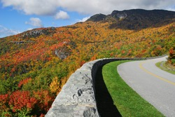 Blue Ridge Parkway Autumn Scenic The Blue Ridge Parkway as it wraps around the backside of Grandfather Mountain in Western North Carolina during full autumn color change.