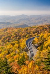 Blue ridge Parkway in Autumn with a secret vantage point of the Linn Cove Viaduct at sunrise