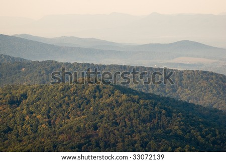 blue rolling hills and green forest