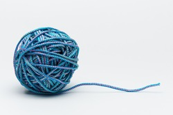 Blue rope and tangled clew on a white background.