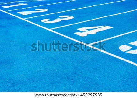 Blue running track. Lanes of a athletic track with numbers. Blue running track in stadium. rubber running tracks in outdoor stadium. Sports Track, Blue, Starting Line