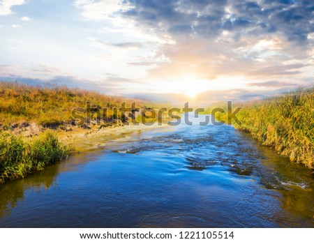 blue rushing river at the sunset