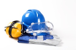 Blue safety helmet with safety gloves earphones and glases. Isolated on a white background.