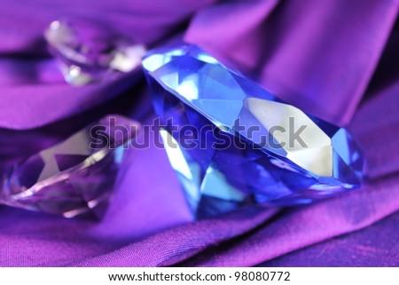 Blue sapphire on purple silk