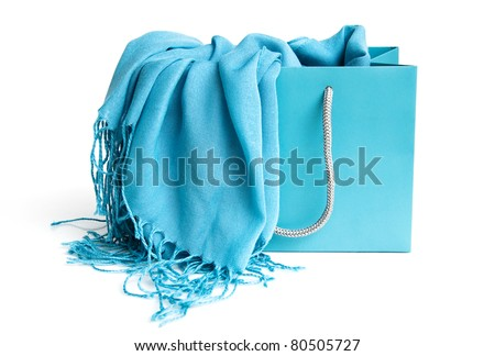 Blue scarf in shopping bag isolated on a white background