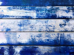 Blue scratch wood wall cracked texture background. Dilapidated wall wooden blue plank panel or worn board background. Old blue wood wall. Vintage peel paint wood plank dilapidated texture background