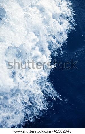 Blue sea active water splash bubble foam texture