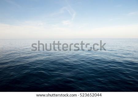 Blue sea and blue sky background. #523652044