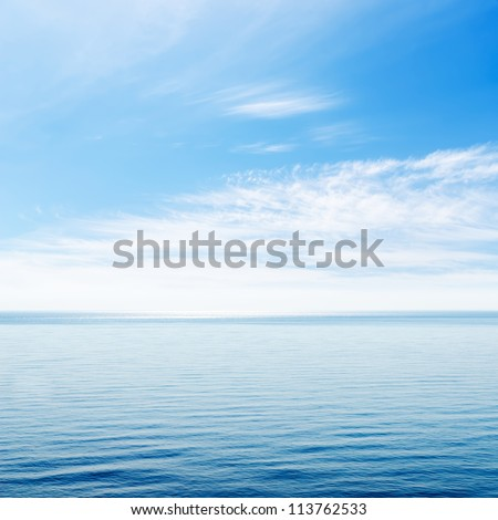 blue sea and cloudy sky over it